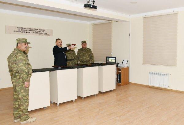 İlham Əliyev silah çəkdi, nişan aldı - FOTOLAR
